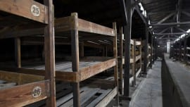 General view of wooden bunks inside a destroyed barracks at the former German Nazi concentration and extermination camp Auschwitz-Birkenau near Oswiecim January 19, 2015. Ceremonies to mark the 70th anniversary of the liberation of the camp will take place on January 27, with some 300 former Auschwitz prisoners taking part in the commemoration event. The Germans built the Auschwitz camp in 1940 as a place of incarceration for the Poles. From 1942, it became the largest site of extermination of the Jews from Europe. In Auschwitz, the Nazi Germans killed at least 1.1 million people, mainly Jews, but also Poles, Roma, Soviet prisoners of war and prisoners of other ethnicities. On January 27, 1945 the camp was liberated by the Red Army soldiers.  Picture taken January 19.             REUTERS/Pawel Ulatowski (POLAND  - Tags: ANNIVERSARY CITYSCAPE)