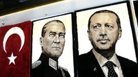 Embroidered images of the founder of modern Turkey Mustafa Kemal Ataturk (L) and Turkey's Prime Minister Recep Tayyip Erdogan (R) are displayed in a shop in the Gaziantep market on January 17, 2014 in Gaziantep, near the Turkish-Syrian border.