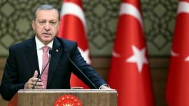 "Turkish President Recep Tayyip Erdogan delivers a speech during an economic meeting with international investors at the Presidential Complex in Ankara on August 02, 2016. President Recep Tayyip Erdogan on August 2, 2016, launched his most bitter attack yet on Turkey's Western allies over the July 15 attempted putsch, accusing them of supporting both ""terror"" and the coup plotters who tried to unseat him. Turkey meanwhile issued arrest warrants for about 100 staff, including doctors, at Ankara's main military hospital, in a new phase of the crackdown after the failed coup that has seen some 18,000 detained and caused international consternation.  / AFP PHOTO / TURKEY'S PRESIDENTIAL PRESS SERVICE / KAYHAN OZER"