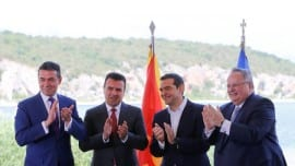Greek Foreign Minister Nikos Kotzias, his Macedonian counterpart Nikola Dimitrov, Greek Prime Minister Alexis Tsipras and Macedonian Prime Minister Zoran Zaev applaud after signing an accord to settle a long dispute over the former Yugoslav republic's name as  look on in the village of Psarades, in Prespes, Greece, June 17, 2018. REUTERS/Alkis Konstantinidis